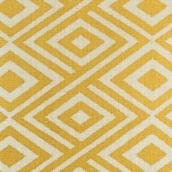 Close up of yellow decorative cushion cover with diamond pattern