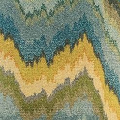 Close up of blue green swirl pattern on cushion cover
