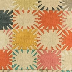 Close up of colourful patchwork pattern on cushion