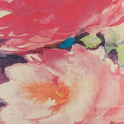 Close up of cushion cover showing watercolour like pink flowers