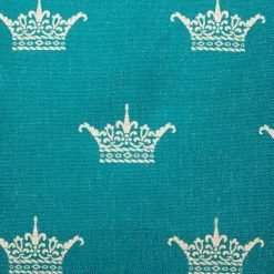 Close up of crown pattern in teal on cushion cover