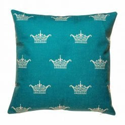 Teal coloured cushion cover with crown pattern