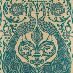 Close up pattern on cushion with turquoise peacock pattern