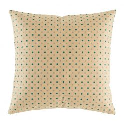 Light coloured cushion with teal polka dot pattern