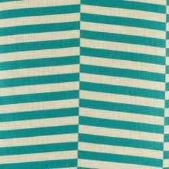 Close up of staggered teal design print on cushion