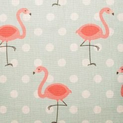 Close up of light blue cushion with flamingo pattern