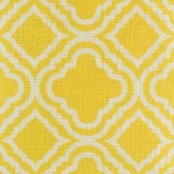 Close up of bright yellow cushion cover with pattern