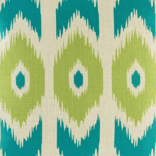 Close up shot of teal and green print on decorative cushion cover