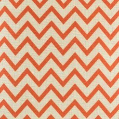 Close up swatch of orange and red zigzag cushion