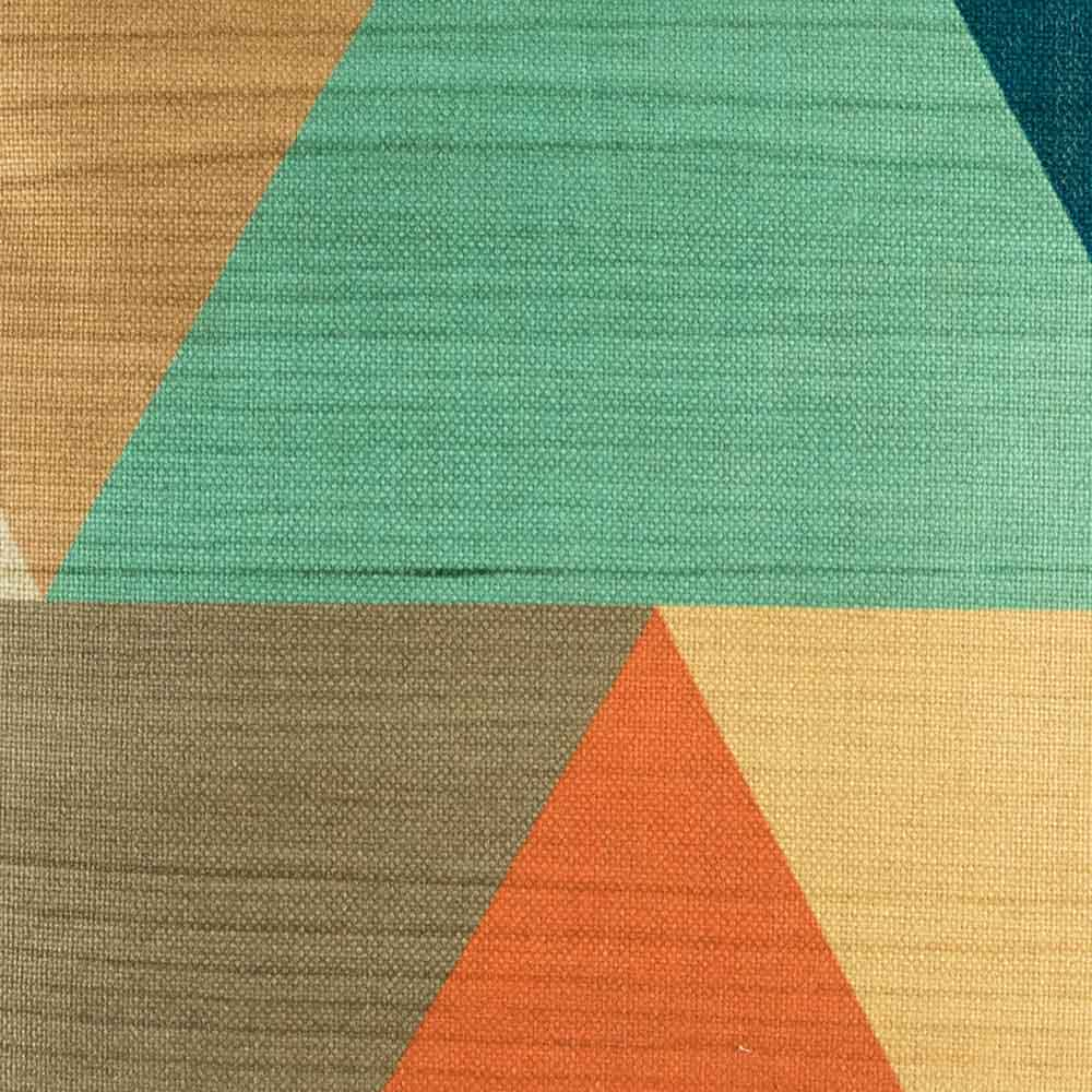 Close up of cushion featuring large triangles in teal and orange