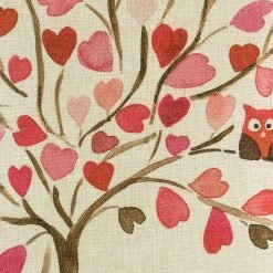 Close up pf pink tree cushion with owl in branches