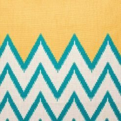 Close up of yellow and teal zig zag scatter cushion
