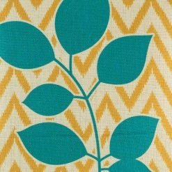 Zoomed in view of yellow zig zag cushion with teal accent