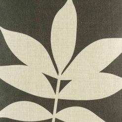 Close up of brown cushion cover with leaf