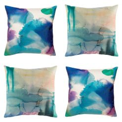 Four cushion covers with tie dyed blue prints
