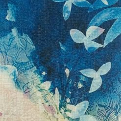 Close up showing blue painted scene of cushion