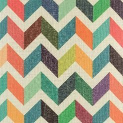 Close up view of colourful chevron cushion cover with rainbow colours