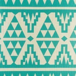 Close up of teal cushion cover with triangular patterning