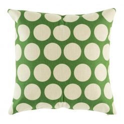 Cushion cover with green background and light coloured polka dot patterning