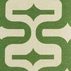 Close view of green geometric swirl on cushion cover