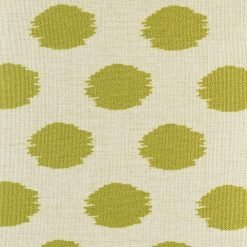 green gold polka pattern up close on cushion cover