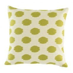Light coloured cushion cover with freehnad polka dots