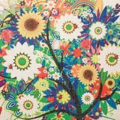 Close up of cushion with colourful tree pattern