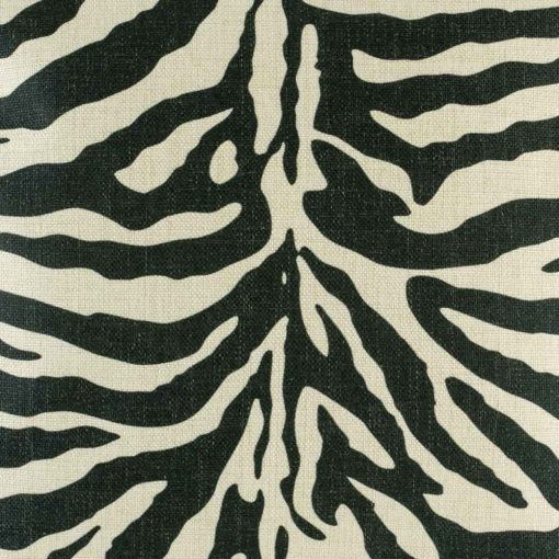 Close up showing black and white zebra print cushion cover