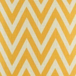 Close up view of yellow zig zag pattern cushion