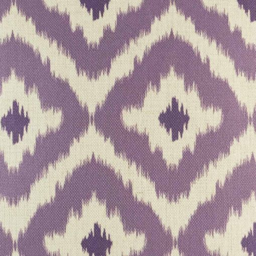 Close up shot of purple cushions cover with geometric shapes