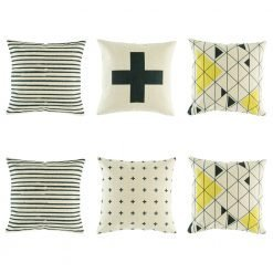 Modern 6 cushion cover set with 2 black striped, 2 black and yellow triangle and 2 cross cushion at different sizes