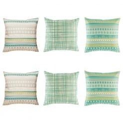 Soft 6 cushion cover set with aztec pattern in grey and teal x2, teal criss cross lines x 2 and an aztec pattern in teal and yellow x 2