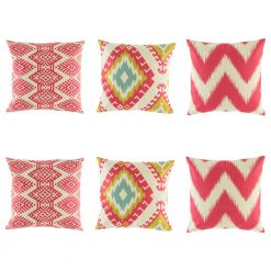 Predominantly pink and red cushion cover set with some light blue and yellow colouring