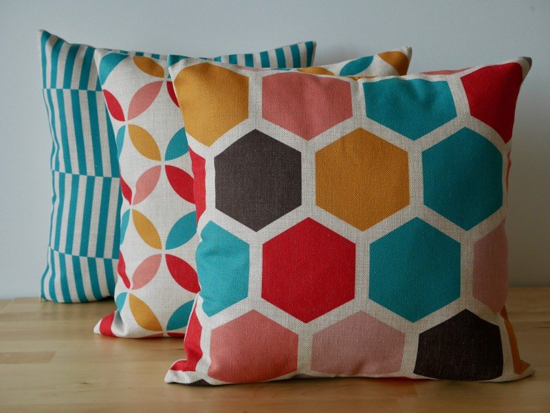 Very colourful cushions stacked in front of one another