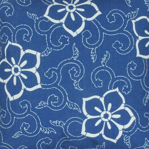 Close up of blue and white floral cotton linen cushion
