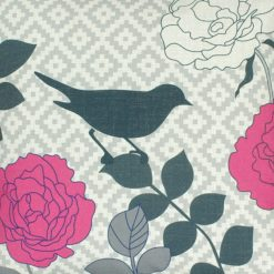 Close up of linen cushion cover with bird and pink flowers