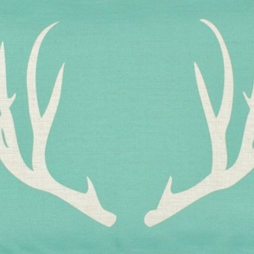 Close up of tiffany blue and white stag design linen cushion