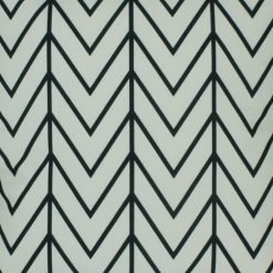 Close up of zigzag and stripe velvet cushion in black and white