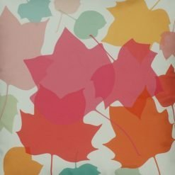 Close up of pastel coloured leaves velvet cushion