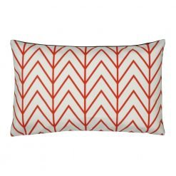 Red and white rectangular velvet cushion with chevron design