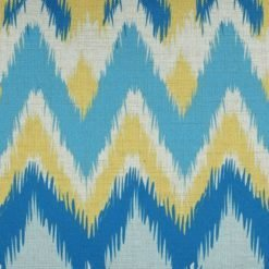 Close-up photo of rectangular chevron cushion cover with blue and yellow colours