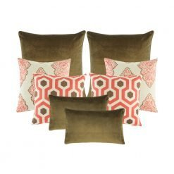 A set of 8 red and brown cushion covers in rectangular and square shapes