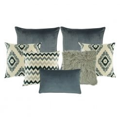 A set of 7 square and rectangular cushions with chevron and diamond patterns and in grey tones