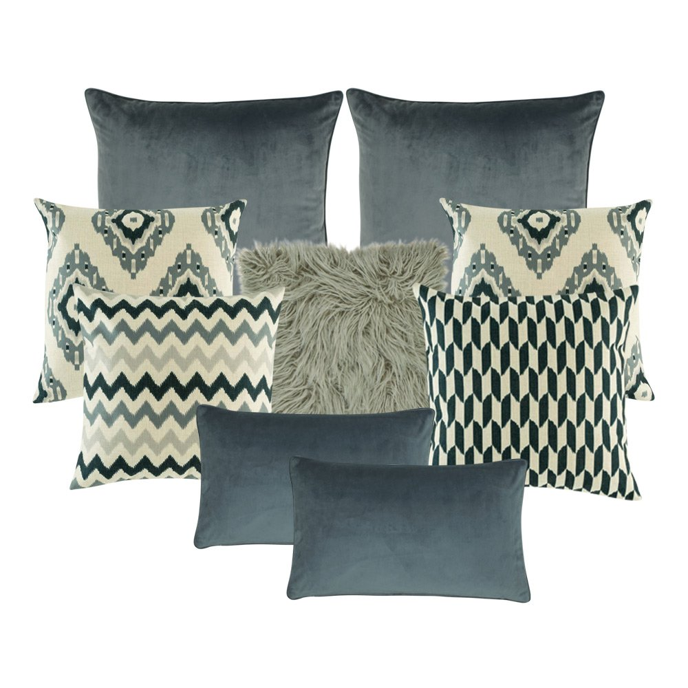 A mix of 9 grey rectangular and square cushions in chevron and diamond designs