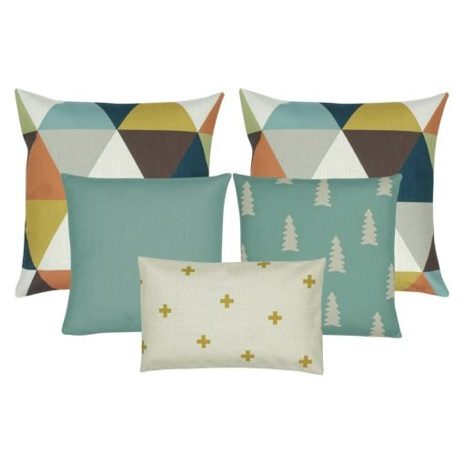 A collection of five cushions with in teal, gold, white, brown and grey colours with pine, triangle and cross designs
