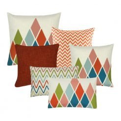 A collection of 6 rectangular and square cushions with diamond and chevron patterns