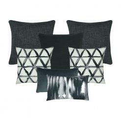 A set of 7 rectangular and square dark grey and white cushion covers