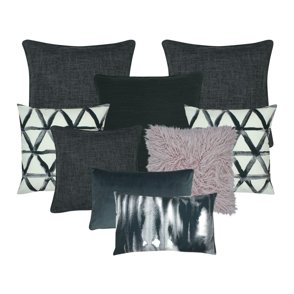 A set of 9 cushion covers with lilac, grey and white colours