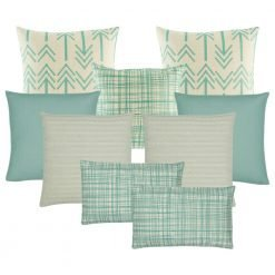 A set of 9 cushions with arrow and line patterns in teal and neutral tones