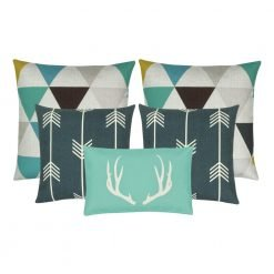 A mix of five cushions in rectangular and square shapes with arrow, moose and triangle designs